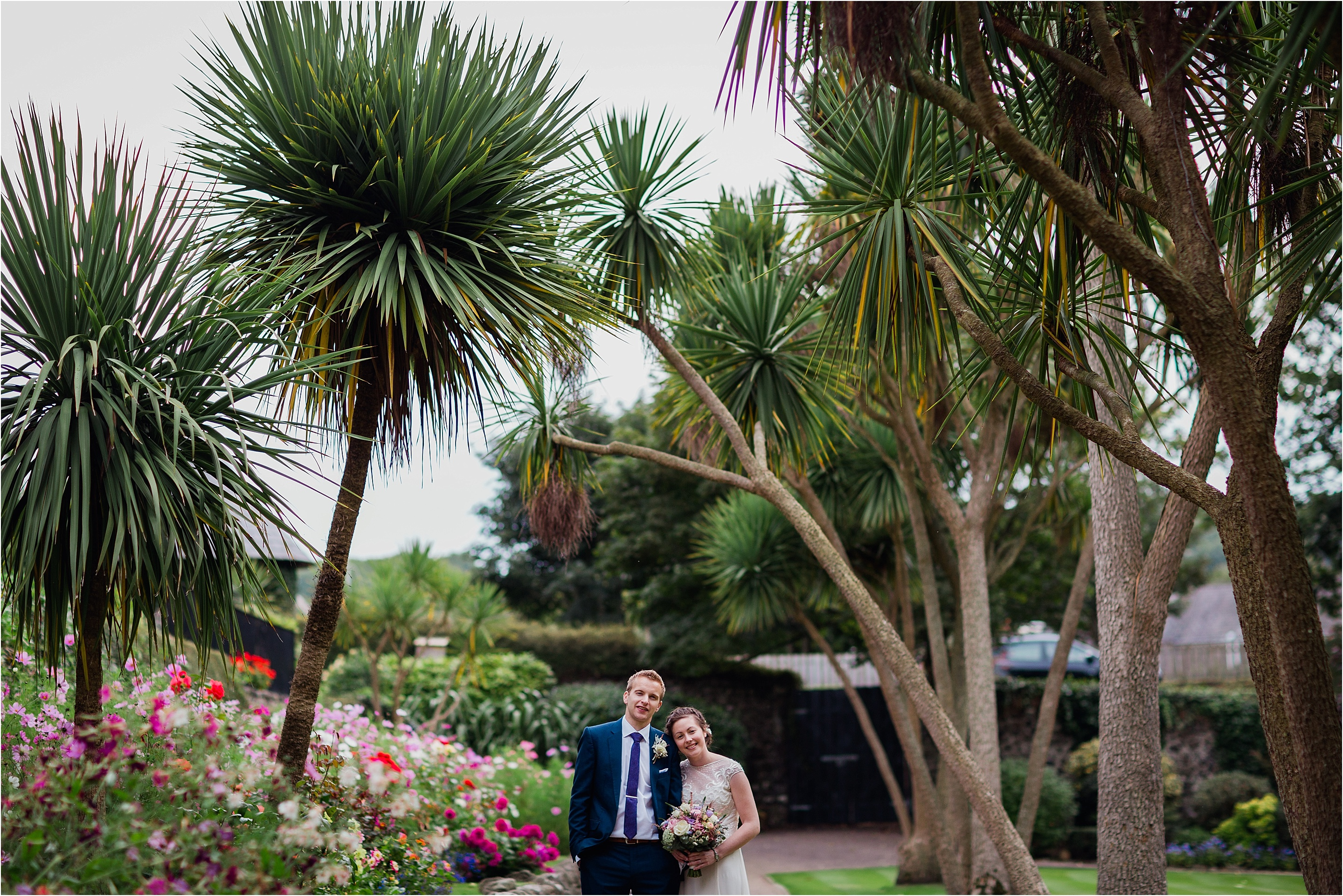 bride and groom under palm trees portrait