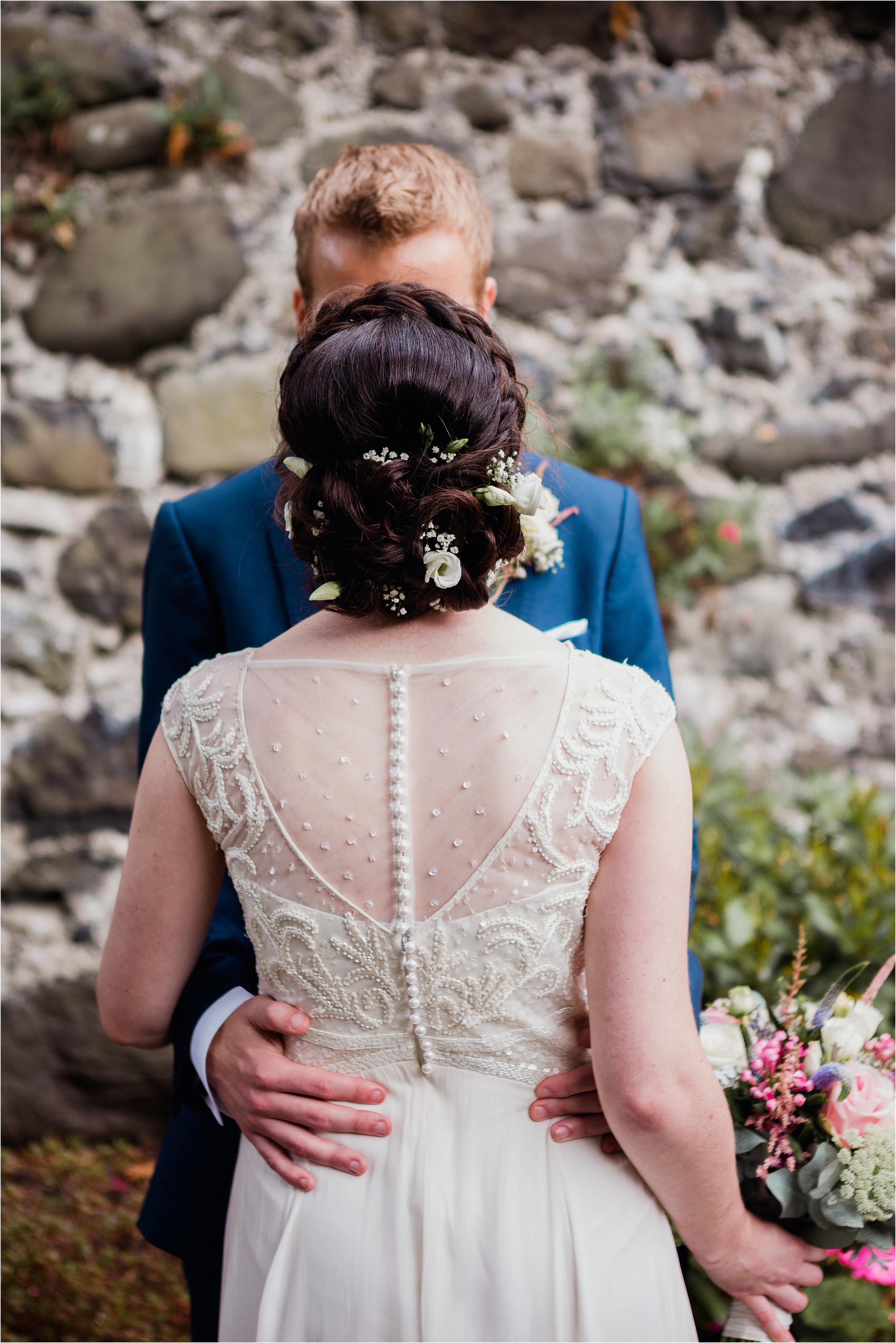 bride flowers in her hair, bride and groom portrait