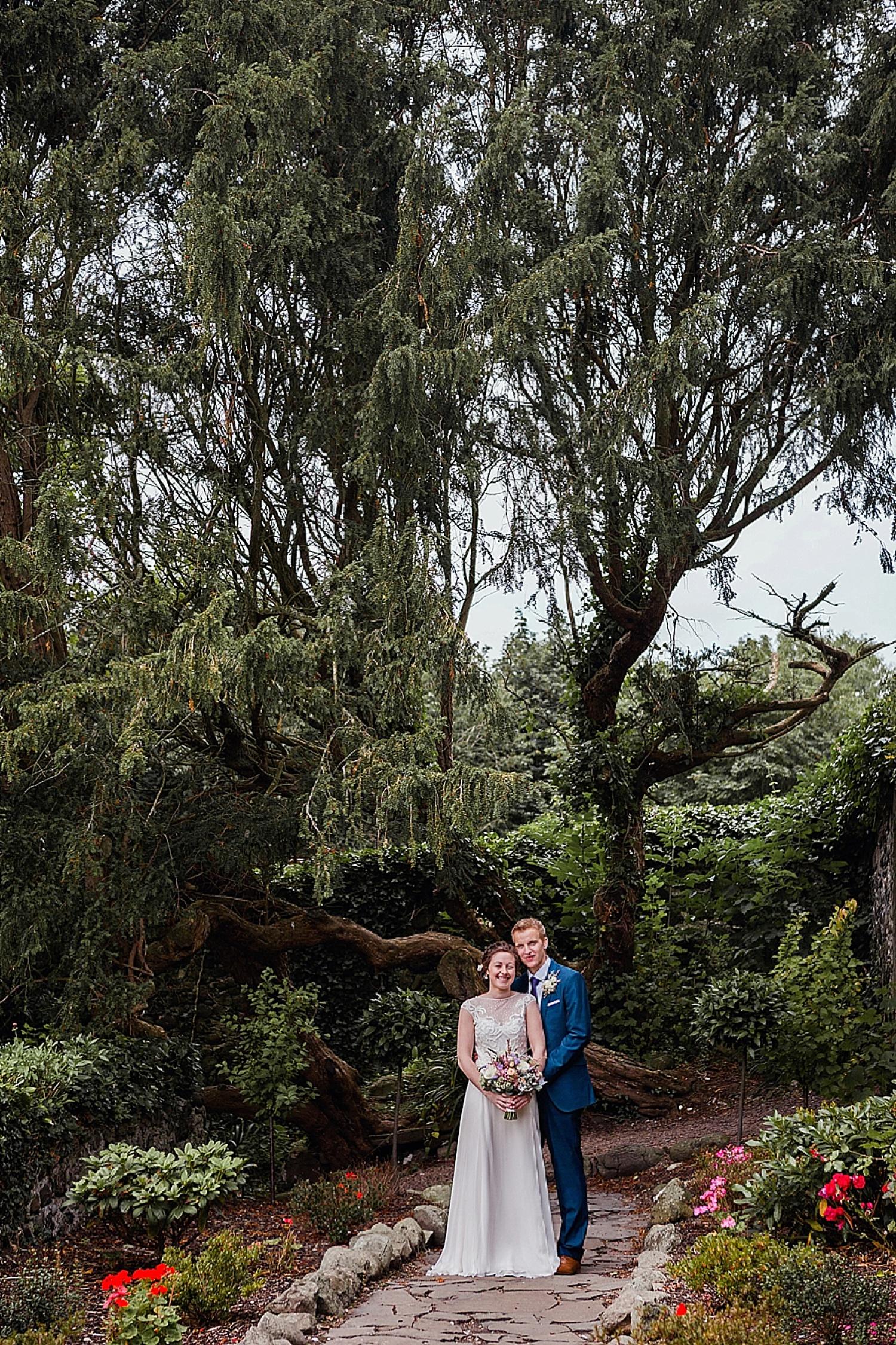 bride and groom portrait in gardens