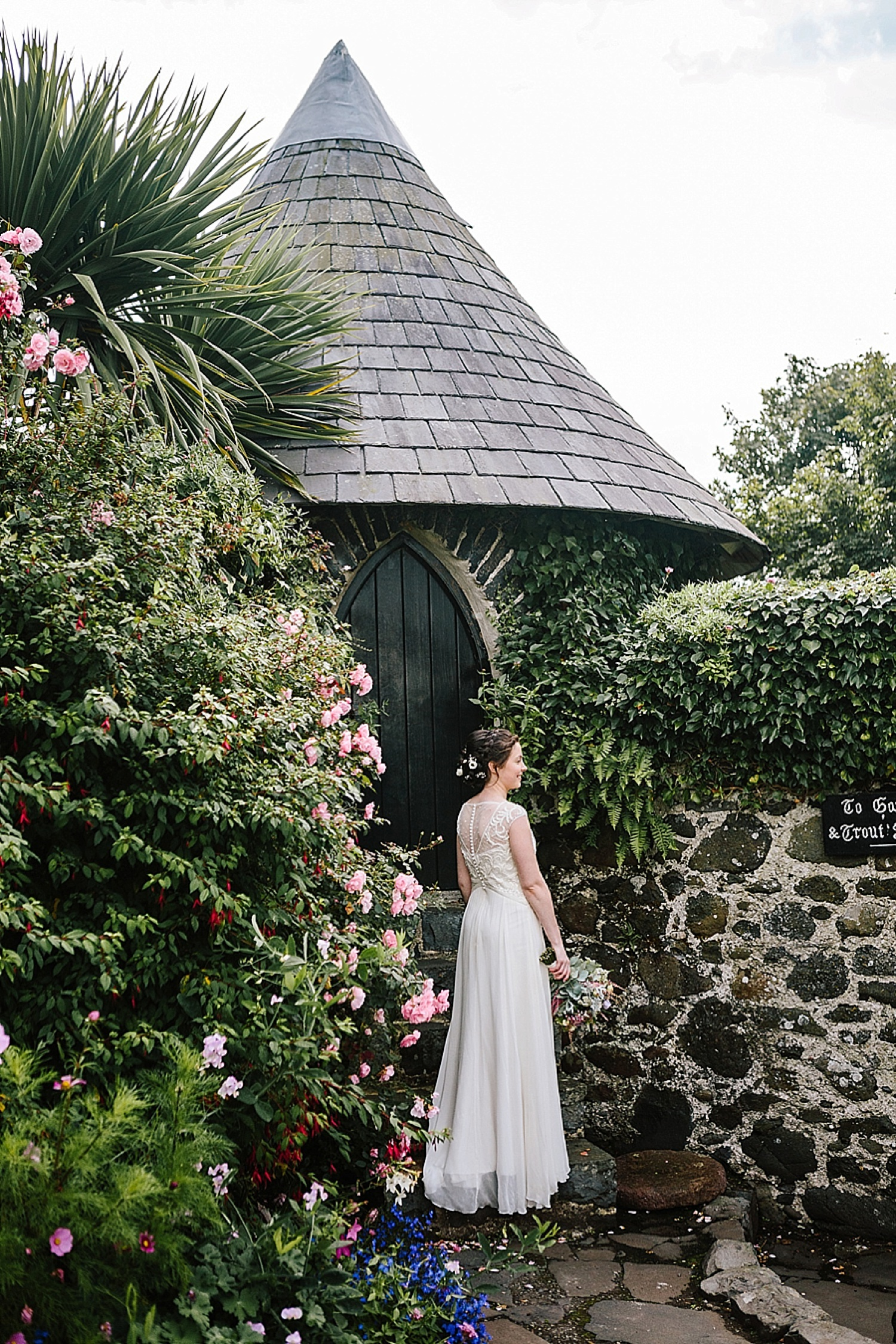 bridal portrait, bride among flowers, bride in walled garden