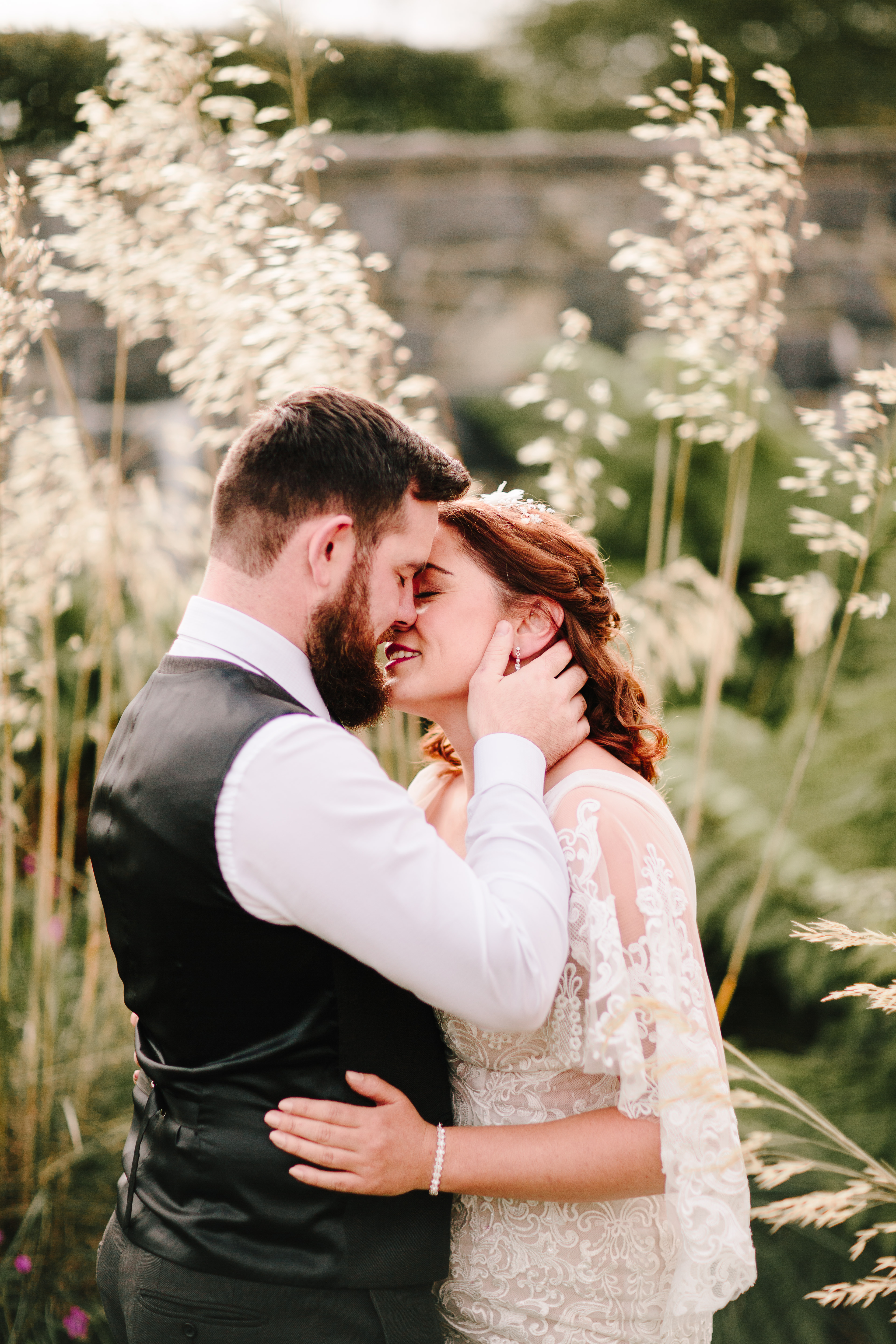 bride and groom among grass