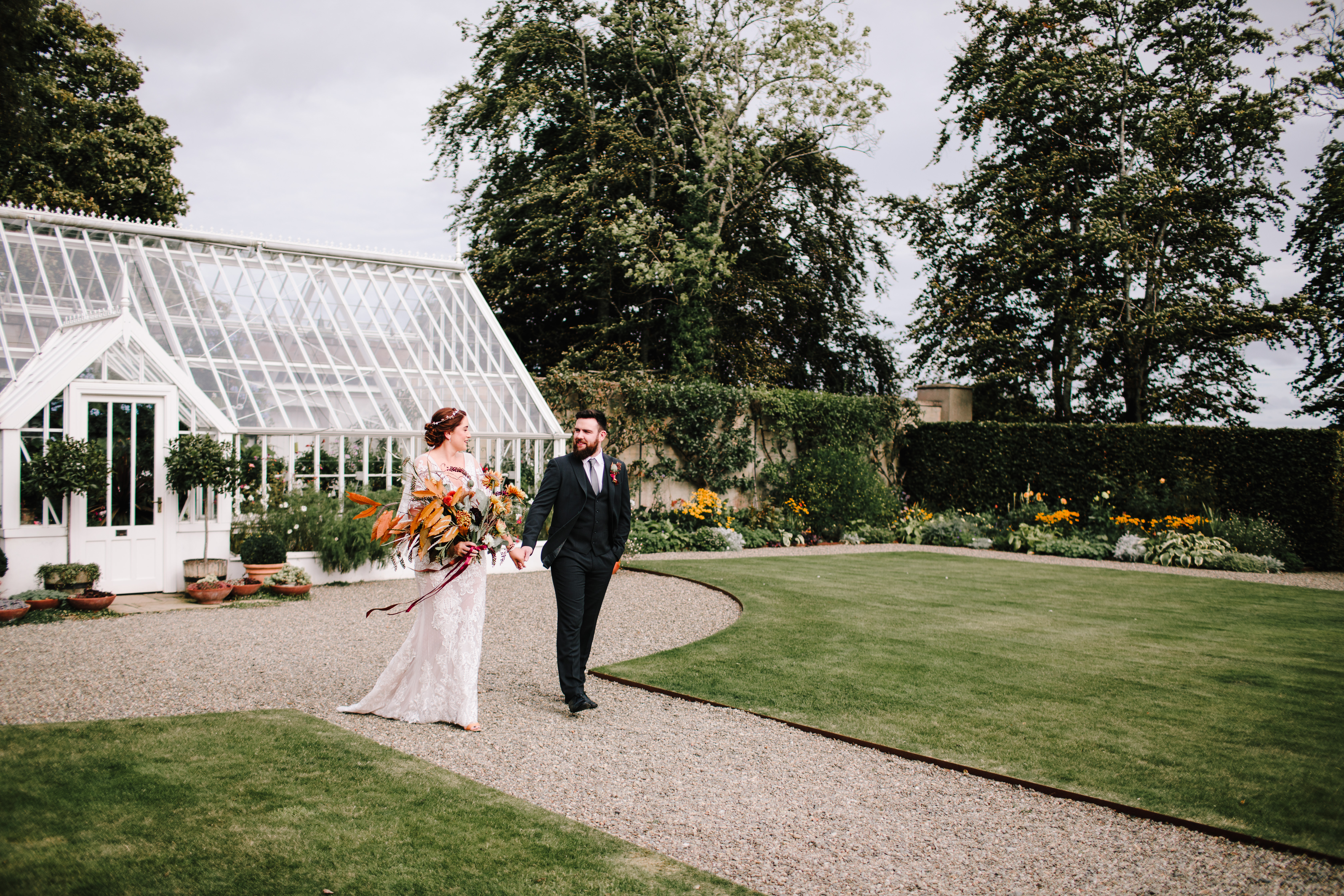 bride and groom in the carriage rooms gardens