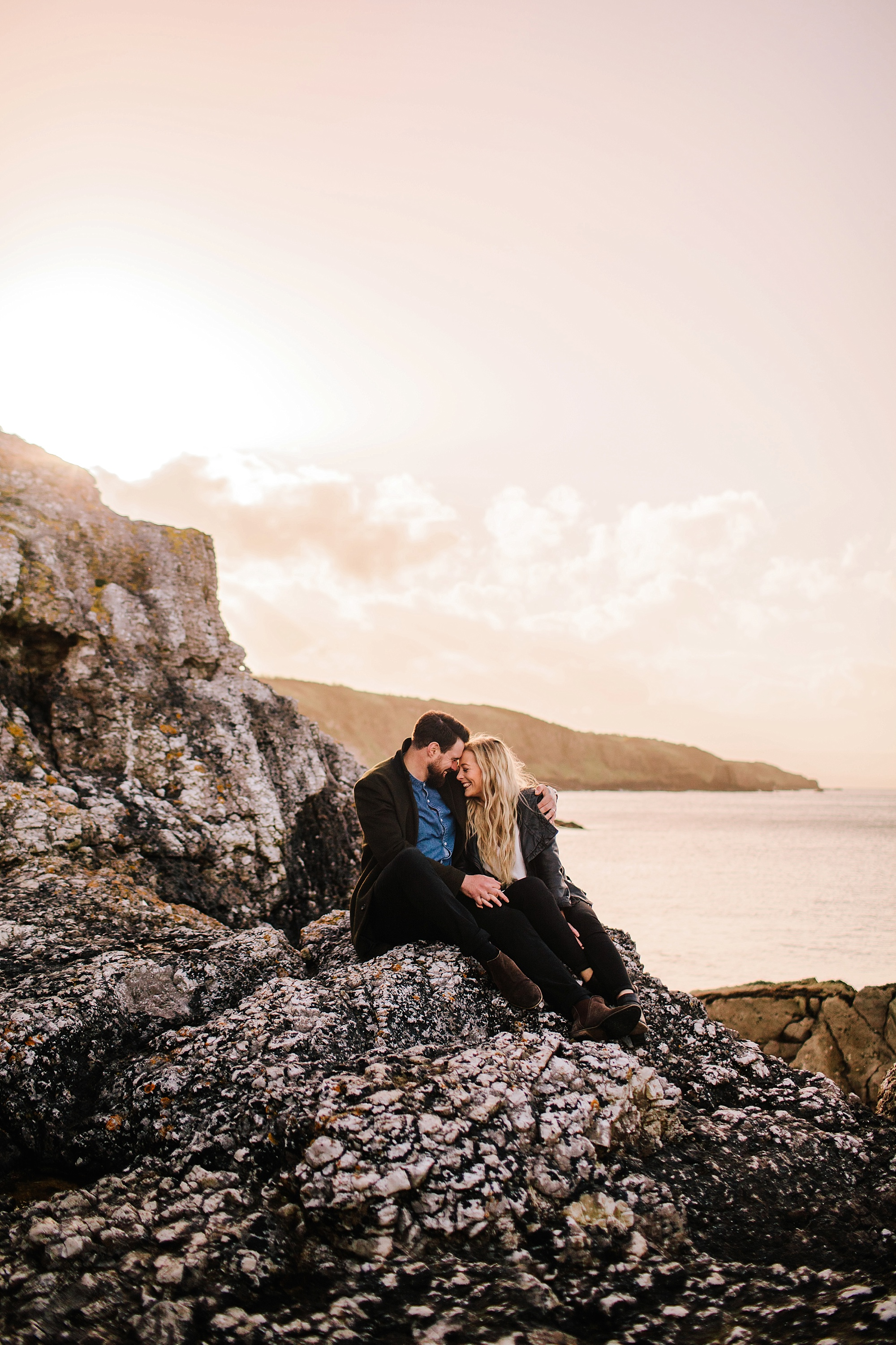 couple on rocks on beach in Ireland