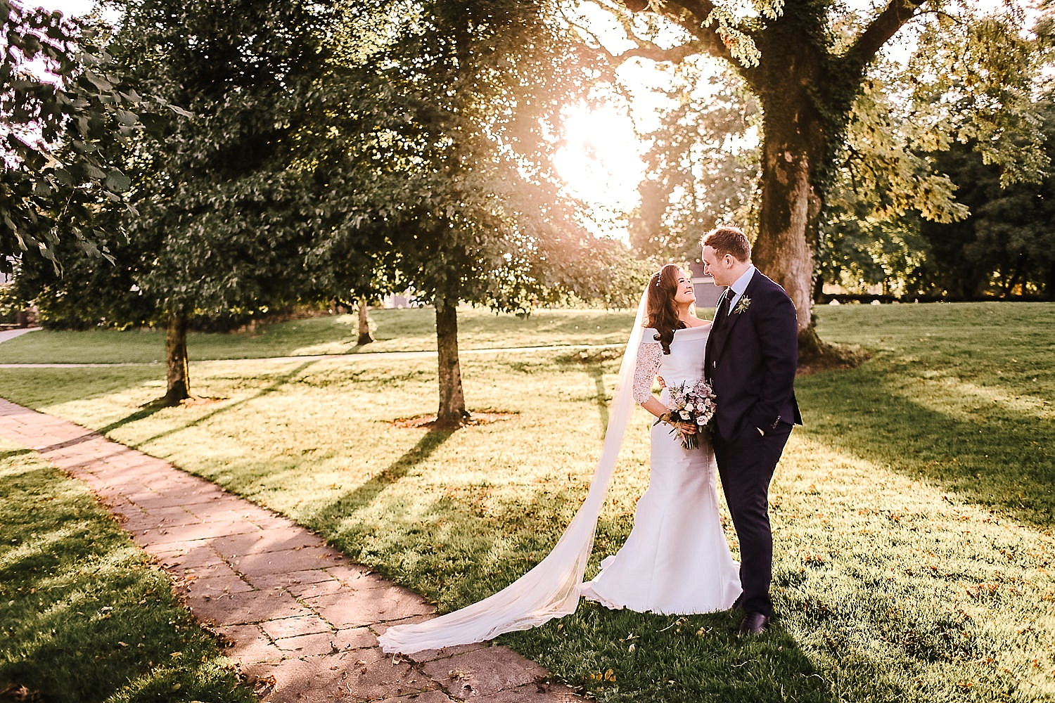 bride and groom in golden sunlight in Ireland