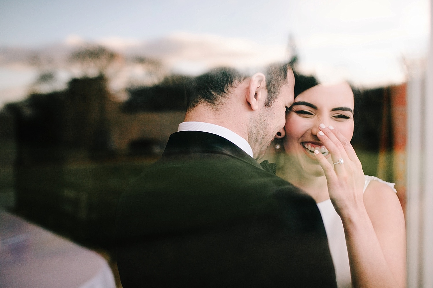 bride laughing along with groom